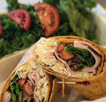 Named after its creator, this delicious wrap features shredded chicken, turkey, strawberries, bacon, Kahlua toasted pecans, fresh parmesan cheese, a splash of Italian dressing, and lettuce.